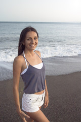 Young woman on the beach in very positive and happy attitude