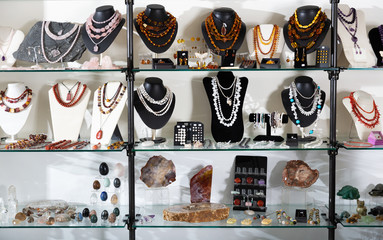 Semiprecious stones jewelry in showcase of shop