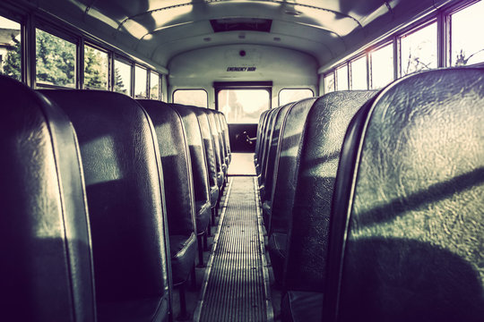 Dark shadowy empty interior of an old school bus