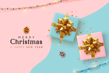 Fototapete - Merry Christmas and Happy New Year. Xmas background with realistic pink and blue gift boxes, festive bright light garland, Holiday banner, poster, greeting card. Advertising flyer brochure. soft color