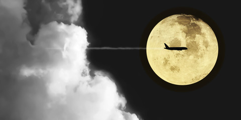 Dramatic atmosphere and lovely romantic beautiful super moon night sky clouds and stars with silhouette aircraft.Image of full moon furnished by NASA.