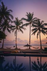 Wall Mural - Beautiful sunset at a beach resort in tropics.