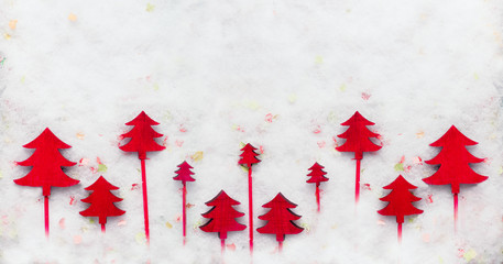 Red Christmas trees on snow . Creative winter holiday concept. Flat lay. Christmas background