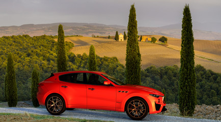 Maserati Levante on the Toscana road during sunset. 3D rendering.Szczecin, Poland-November 2019