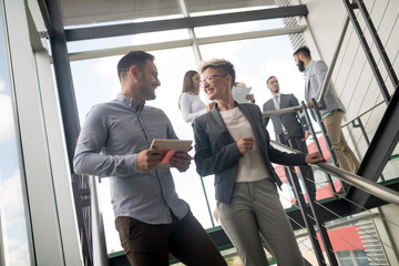 Wall Mural - Business people having fun in modern office