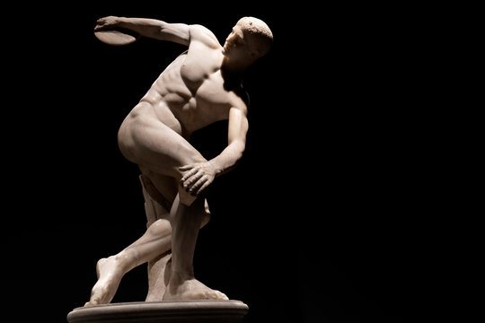 Discus thrower discobolo statue isolated on black