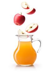 Apples dropping on a jug of apple cider vinegar
