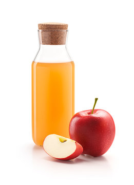 Bottle of apple cider vinegar with fresh red apples isolated on white background