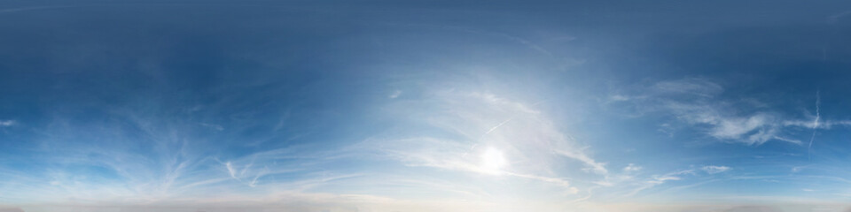 blue sky with clouds with evening sun. Seamless hdri panorama 360 degrees angle view with zenith for use in 3d graphics or game development as sky dome or edit drone shot