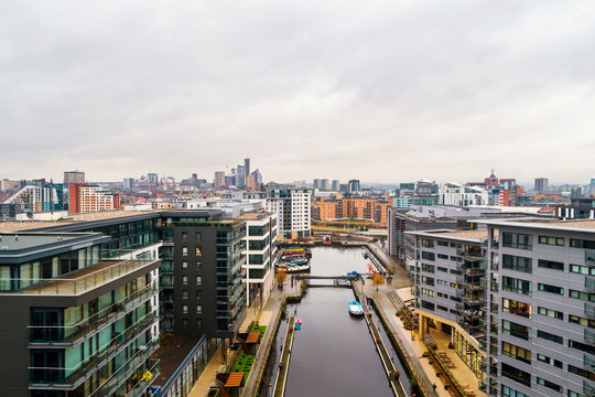 Aerial view of Leeds docks, England, UK. Heavy clouds over the modern buildings