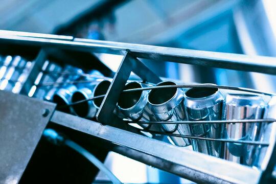 Conveyor belt with beer cans. Production of beer beverage,  bottling in banks.