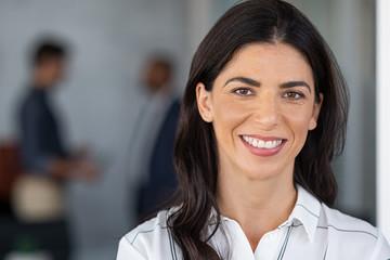 Confident mature business woman smiling