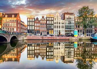 Fototapeten Amsterdam Amsterdam Canal houses at sunset reflections, Netherlands