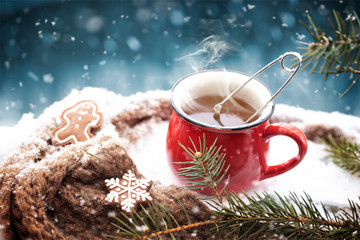 Hot tea outdoor with knitted scarf
