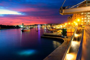 Beautiful twilight sky with embankment background. Landscape of Sliema, Malta.