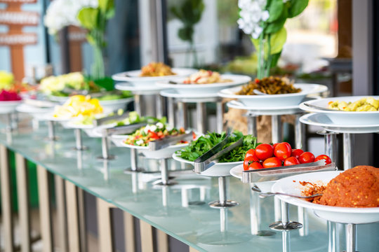 A delicious appetizer and salad buffet with various options in a restaurant or hotel
