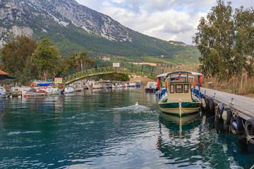 Azmak river with boats in Akyaka, Mugla, Turkey