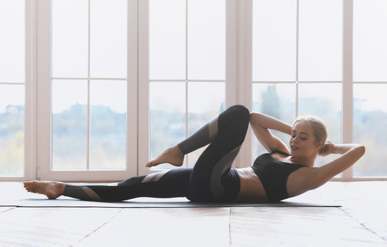 Gymnastic girl working out at fitness studio