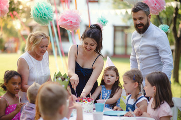 Kids birthday party outdoors in garden in summer, celebration concept.