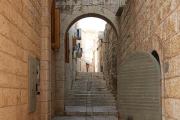 Fototapeta Small passage in old city of Jerusalem