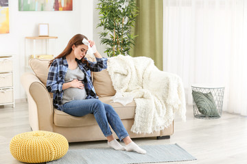 Pregnant woman ill with flu at home