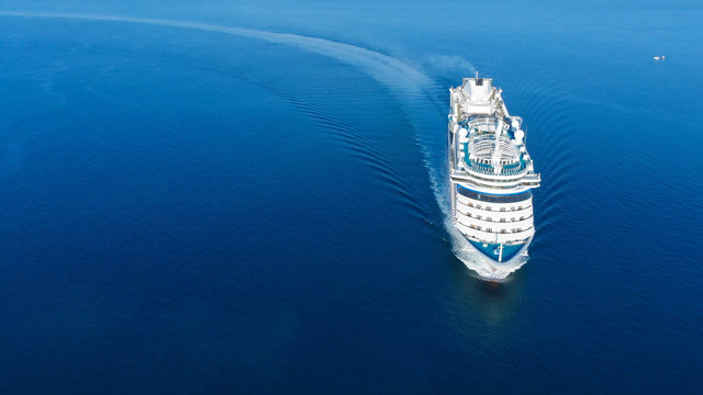 Aerial view of beautiful white cruise ship above luxury cruise in the ocean sea  concept tourism travel on holiday take a vacation time on summer.
