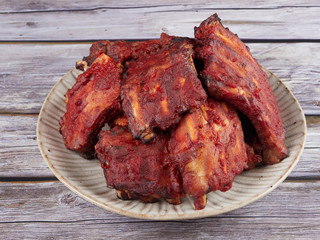 Homemade oven baked spareribs on rustic wooden background