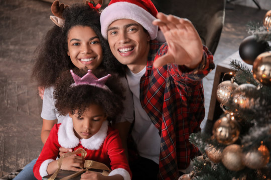 Happy African-American family at home on Christmas eve