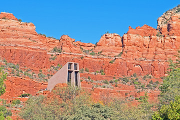 The Chapel of the Holy Cross in Sedona, Arizona, is situated against a backdrop of a red rock rampart.