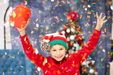 Happy Christmas child with gifts. Christmas holidays