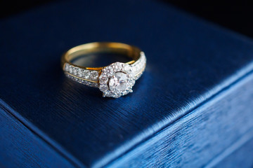wedding gold diamond ring on jewelry box