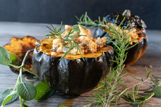 Baked acorn squash bowl with stuffing with rosemary and sage rustic