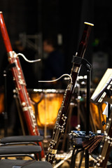 Fototapete - Bassoons standing on stage on stands in dark colors