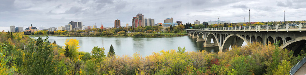 Panorama of Saskatoon, Canada skyline over river