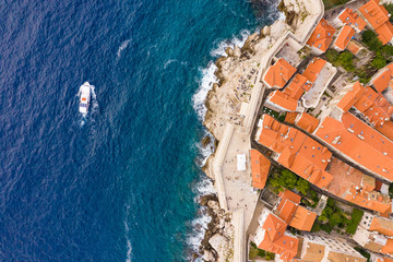 Aerial view of boat sailing near Dubrovnik old town, Croatia.