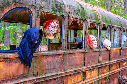 Halloween Masks in a Horror School Bus in a junkyard