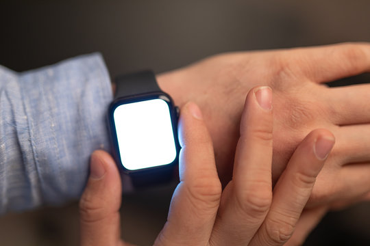 Close up of Businessman's hand looking at hand watch