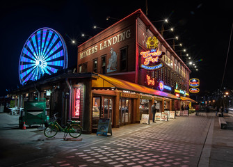 Seattle, Washington, USA – November 21, 2019 Miners Landing and the Great Wheel along Seattle's waterfront at Pier 57