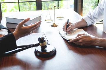 Professional male lawyer or counselor discussing negotiation legal case with client meeting with document contract in office, law and justice, attorney, lawsuit concept