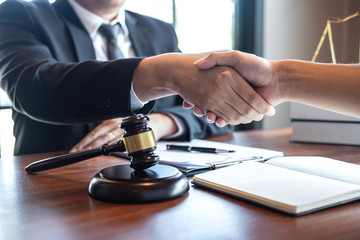 Handshake after good deal negotiation cooperation, Professional male lawyer or counselor and client meeting, working with legal case document contract in office, law and justice, attorney, lawsuit