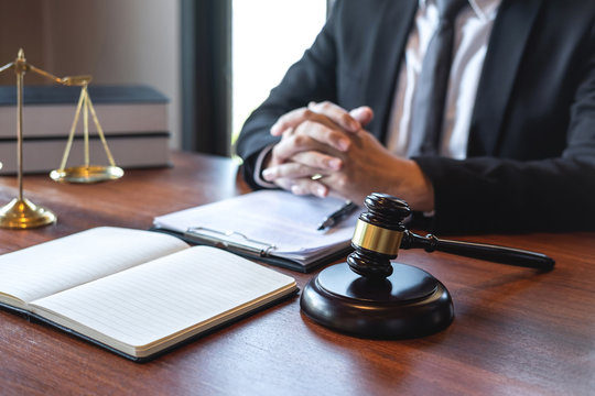 Professional male lawyer or counselor working with legal case document contract in office, law and justice, attorney, lawsuit concept