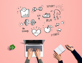 Fitness and diet with people working together with laptop and notebook