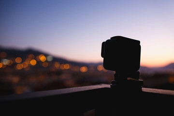 Taking timelaps video on action camera on sunset or sunrise. Mountains, dusk.