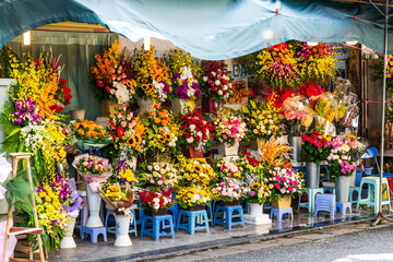 Bunches of bright flowers in bouquets on display outside a shop in Hanoi, Vietnam, Asia