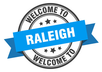 Raleigh stamp. welcome to Raleigh blue sign