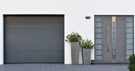 Modern gray garage, next to the Scandinavian-style house. Private garage with automatic door in a European city in Germany Fotomurales