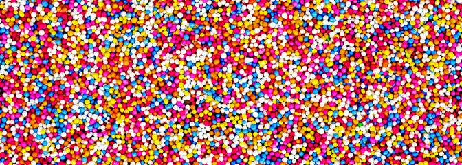 Fun, multicolor abstract of cake toppings, 100's and 1000's - candy banner / panorama / header for sweet design - food concept.