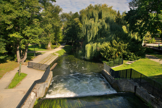Waterfall Niagara at Lyna river and alley Chateauroux at Park Podzamcze in Olsztyn. Poland