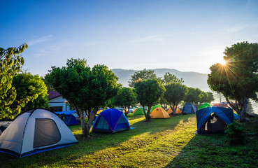 Photo sur Aluminium Camping Camping and tent in nature park with sunrise