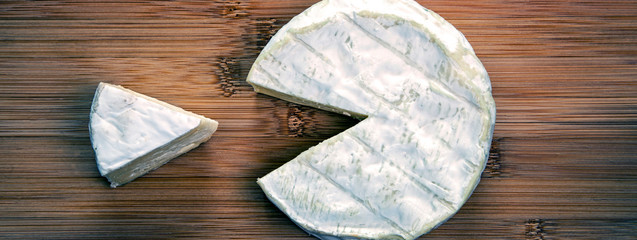 Cheese! Easy and lovely to eat! Food concept - camembert cheese & portion. Rustic, natural style - food concept in a panorama / banner / header design.